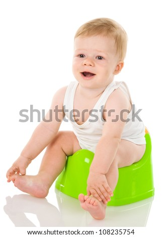 smiling baby on chamber-pot. isolated on white background - stock photo