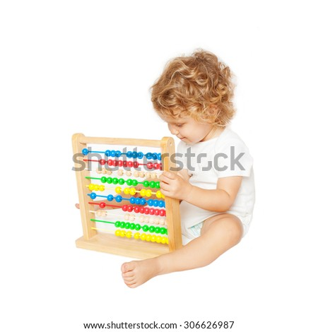 Smiling baby playing with abacus. Isolated on white background
