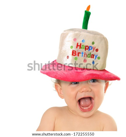 Smiling baby wearing a Happy Birthday hat.  - stock photo