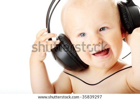 Smiling baby with headphone isolated on white background - stock photo