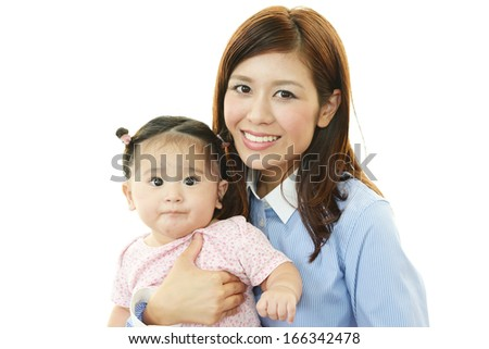 Smiling baby with mother