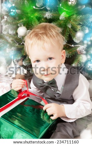 Smiling baby with present gift box while Christmas time - stock photo