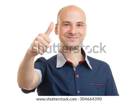 Smiling bald guy showing thumbs up. Isolated - stock photo