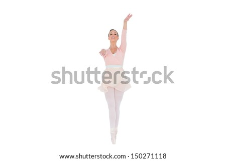 Smiling ballerina with her arms extended on white background  - stock photo