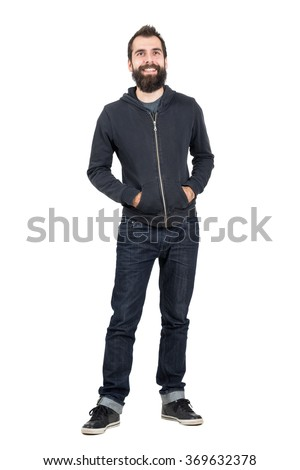 Smiling bearded hipster with smiley piercing on upper lips. Full body length portrait isolated over white studio background.  - stock photo