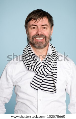 Smiling bearded man of middle age - stock photo