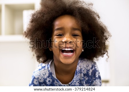 Smiling beautiful african girl with healthy white teeth - stock photo