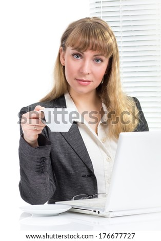 Smiling  beautiful businesswoman holding cup coffee or tea sitting at desk