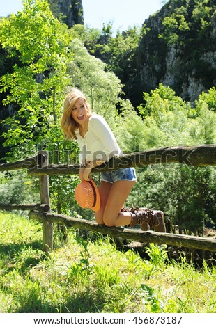 Smiling beautiful girl have fun at the countryside