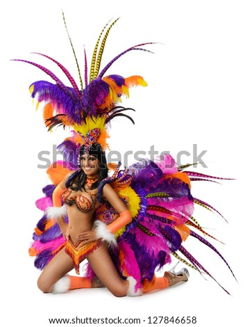 Smiling beautiful girl in a colorful carnival costume - stock photo