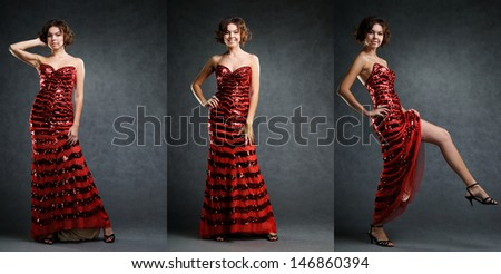 Smiling beautiful girl in long red dress posing in studio on grey background. - stock photo