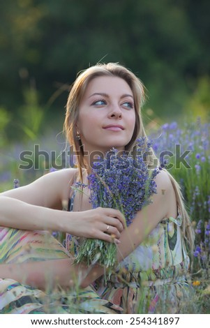 smiling beautiful girl in the lavender field