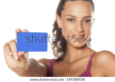 smiling beautiful girl showing her credit card - stock photo