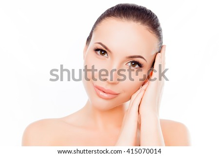 Smiling beautiful girl showing her hands with smooth skin