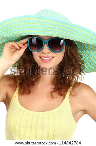Smiling beautiful girl with beach hat and glasses isolated on white