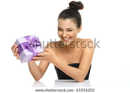 Smiling beautiful girl with gift box. Photo girl of european appearance on a white background.
