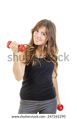 Smiling beautiful sporty fit athletic girl with weights or red dumbbells wearing sports clothing isolated over white background. Weight loss woman. Caucasian female fitness model - stock photo