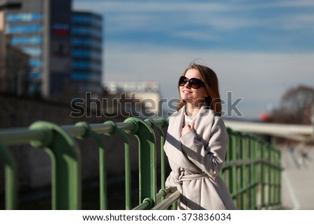 Smiling beautiful woman enjoying the sun on a winter day