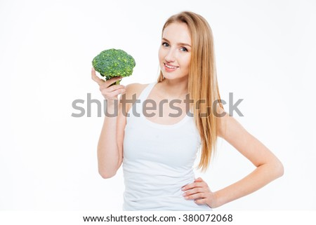 Smiling beautiful woman holding cauliflower isolated on a white background