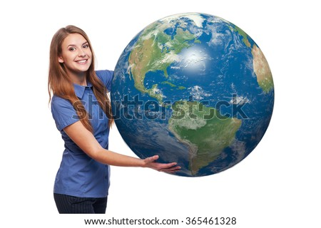 Smiling beautiful woman holding earth globe in her hands, American continent in front, over white background