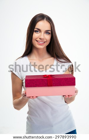 Smiling beautiful woman holding gift box isolated on a white background