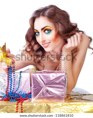 smiling beautiful woman with bright make-up and gift boxes - stock photo
