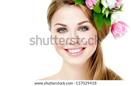 Smiling beautiful woman with flowers in her hair - stock photo