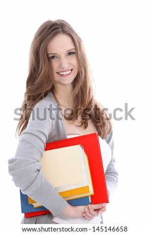 Smiling beautiful young teeager female student with her books for class tucked under her arm, isolated on white