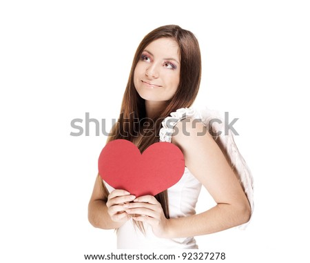 smiling beautiful young woman looking at left corner and holding a paper valentine's day red heart , valentines day. isolated on white background