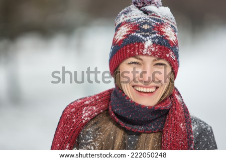 Smiling beautiful young woman relaxing outdoor in a winter day - stock photo