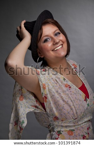 smiling beautiful young woman with a hat - stock photo