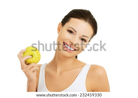 Smiling beauty holding green apple. - stock photo