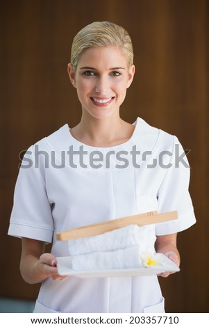 Beautician uniform stock photos images pictures for Uniform spa vector