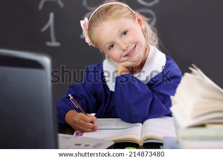 Smiling behind the counter of school #2 - stock photo