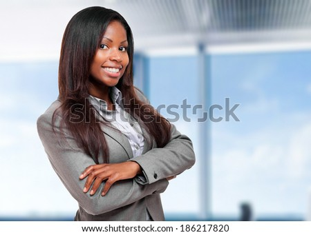 Smiling black business woman in her office - stock photo