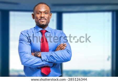 Smiling black businessman in the office - stock photo