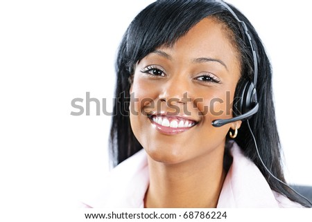 Smiling black customer service and support woman wearing headset