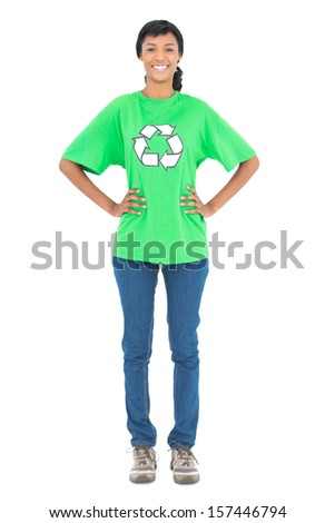 Smiling black haired ecologist posing with hands on the hips on white background - stock photo