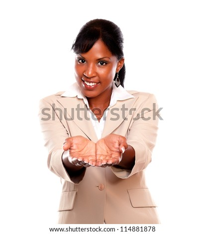 Smiling black woman looking at you against white background - stock photo