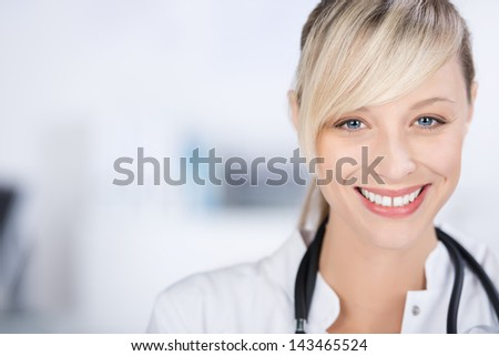 Smiling blond doctor against the white background - stock photo