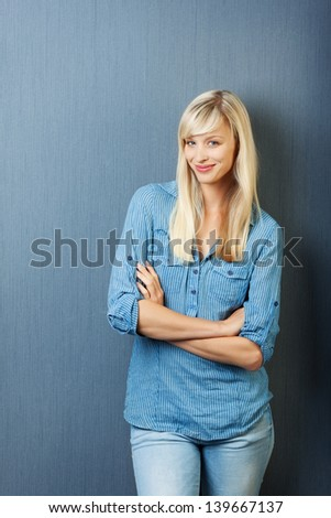 Smiling blond female posing with arm crossed isolated on