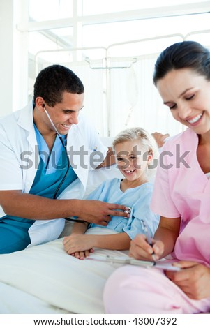 Smiling blond girl at a checkup in a hospital