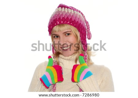 Smiling blond girl in cap and Multi-coloured gloves - stock photo