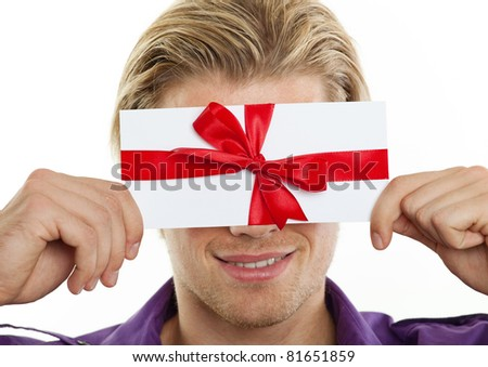 smiling blond man with voucher - stock photo