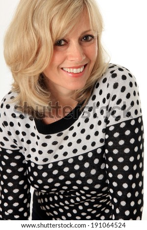 Smiling blond woman age 49, studio isolated on white. - stock photo