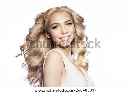 Smiling blond woman studio portrait