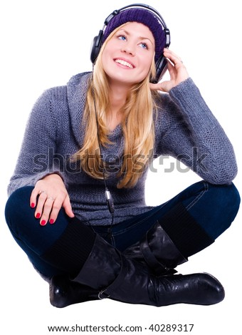 smiling blond young woman in winter clothes over white background - stock photo