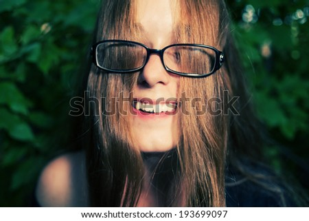 Smiling blonde weared glasses funny shot