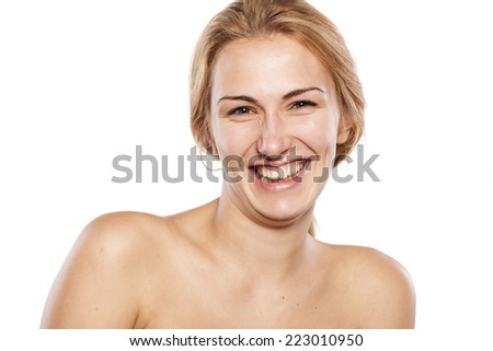 smiling blonde without makeup posing on white background - stock photo