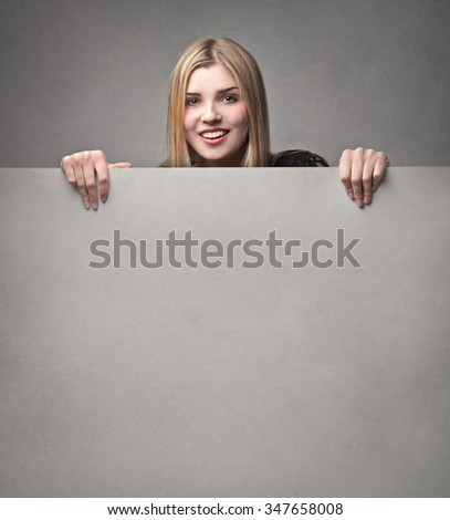 Smiling blonde woman - stock photo